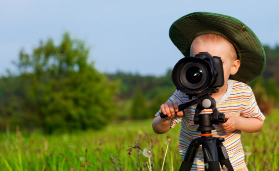 Boy Taking A Photo With A Camera